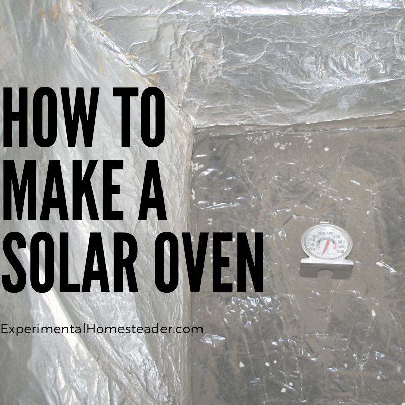 The inside of the homemade solar oven with a oven thermometer in it.