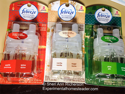 Three of the Febreze Holiday Collection scents in package.