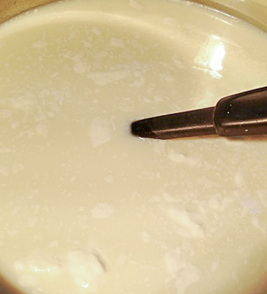 Goat milk in a pan being brought to a boil to make this easy cajeta goat milk caramel recipe.