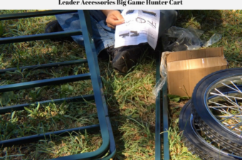 Pieces of the game hunter cart laying on the ground and Jeffrey holding the assembly instructions.