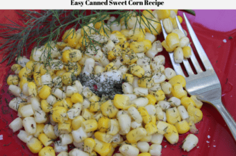 Freshlike Selects Gold & White Corn on a red plate with a sprig of dill weed off to the side and fresh dill weed plus butter on the corn.