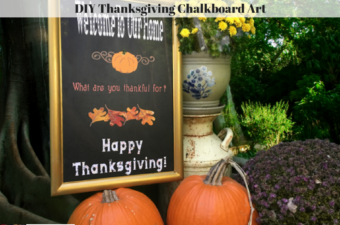 The completed Thanksgiving Chalkboard Art Project surround by pumpkins, mums and an antique milk can.