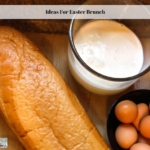 French bread, milk and eggs on a cutting board.