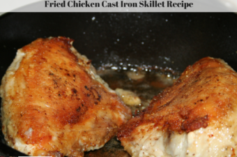 This photo is of browned fried chicken breasts in a cast iron skillet.