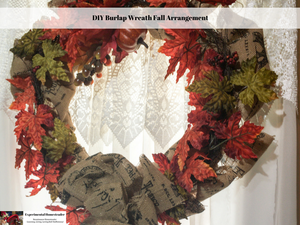 A DIY Burlap Wreath Fall Arrangement hanging on the front door.
