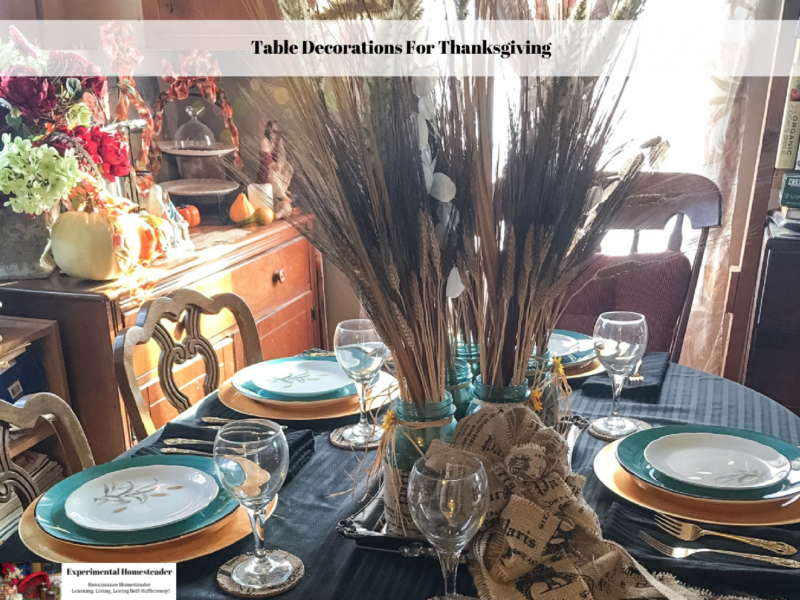 A Thanksgiving table set with dishes and a centerpiece.