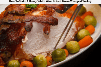 A bacon wrapped turkey on a platter being carved with Brussels sprouts and carrots on the edges of the platter.