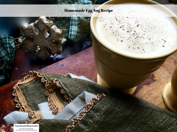 A cup of homemade eggnog sitting on a table.