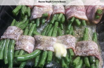 Bacon wrapped maple green beans, wrapped with a dash of butter on top ready to go into the oven to bake.
