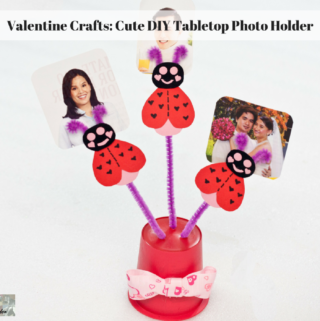 The completed tabletop photo holder with photos in it.
