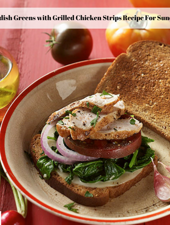 An open faced braised radish greens with grilled chicken sandwich on a plate surrounded by olive oil, whole ripe tomatoes and radishes with the tops intact.