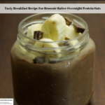 The photo shows the ready to eat Brownie Batter Overnight Protein Oats topped with bananas and dark chocolate chunks.