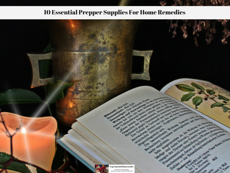 A candle, a morter and pestle and an open book.