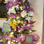 Silk flowers, fake Easter eggs and repurposed decorations on an Easter holiday tree.