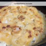 The finished cast iron potatoes au gratin recipe ready to serve.