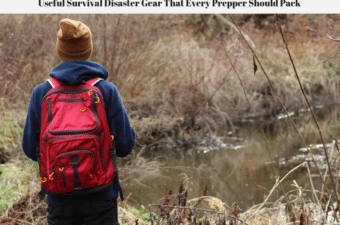 A person in the wilderness with a bug out backpack standing near a creek.