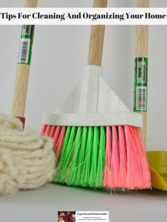A mop, broom and dishpan standing against the wall.