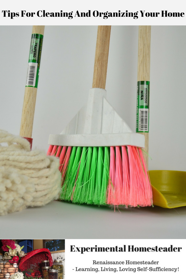 A mop, broom and dustpan standing against the wall.