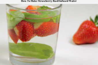 Fresh strawberries and fresh basil in a glass of water.