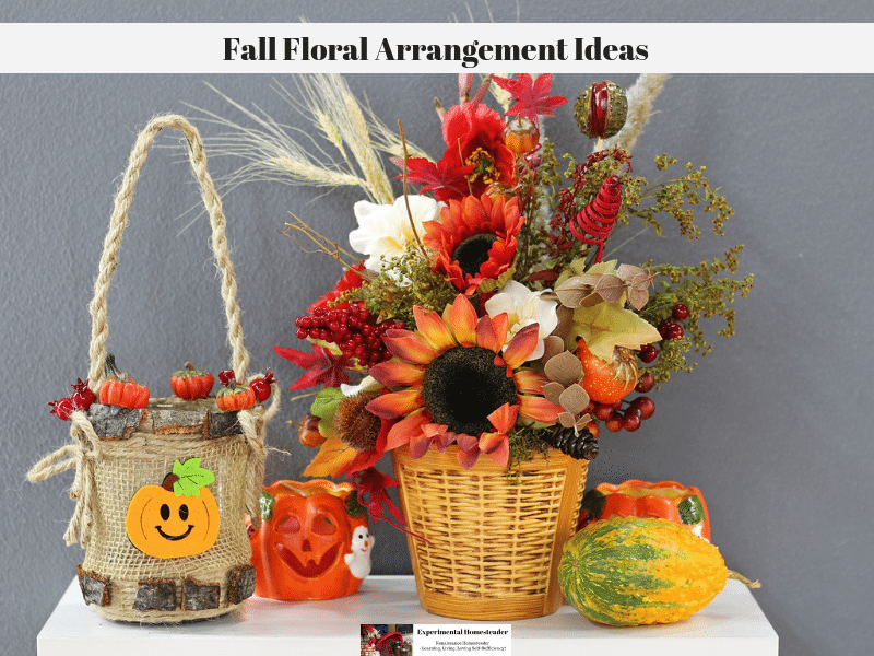 Fall flowers in a wicker basket with a gourd, a ceramic pumpkin and a wicker basket pumpkin sitting on a table.