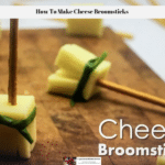 The photo shows a cheese broomsticks on a cutting board.
