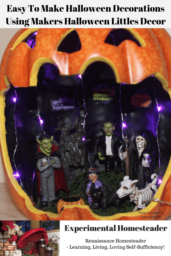 A ready to display Maker's Halloween Littles Jack O'Lantern Container Fairy Garden lit up with purple LED lights.