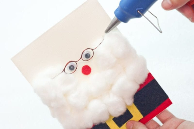 Santa's glasses being glued to the front of the cute handmade card.