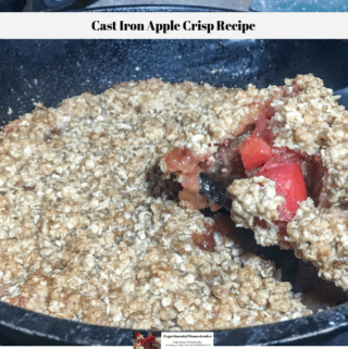 A slice of the apple crisp being removed from the cast iron skillet.