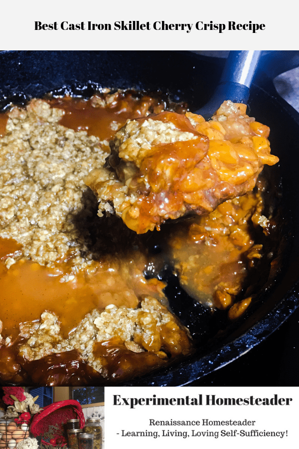 Cherry crisp being dipped out of a cast iron skillet.
