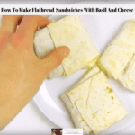 Healthy flatbread sandwiches with basil and cheese being picked up off a plate.