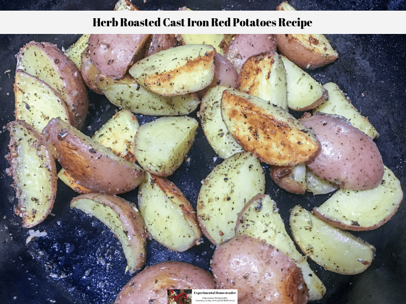 Herb roasted cast iron red potatoes in a cast iron skillet.