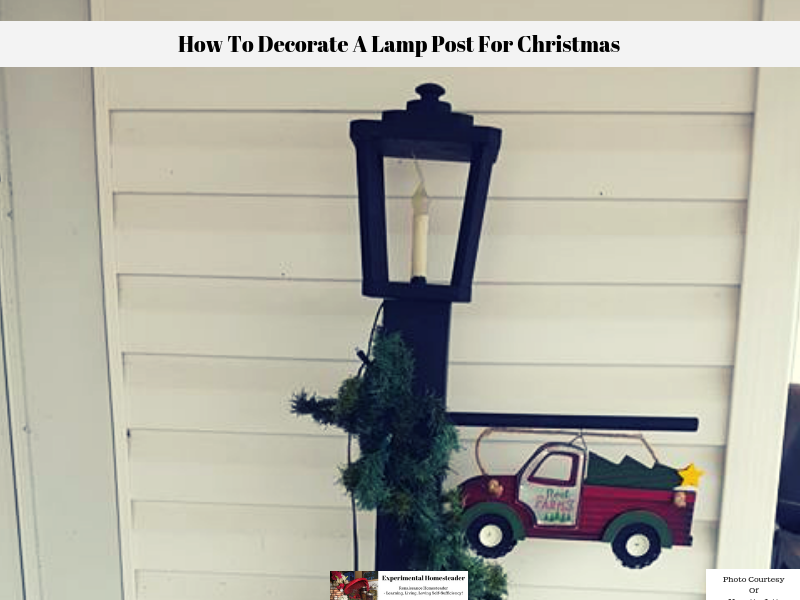 A photo showing how to decorate a lamp post for Christmas.