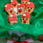 Cute Santa Claus Nutter Butter Christmas Cookie Ideas tucked into a dish nestled among tissue paper.
