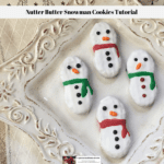 Decorated Nutter Butter Snowman Cookies on a plate.