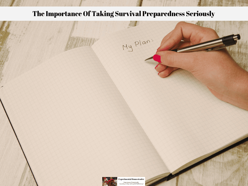A lady writing a survival preparedness plan in a notebook.
