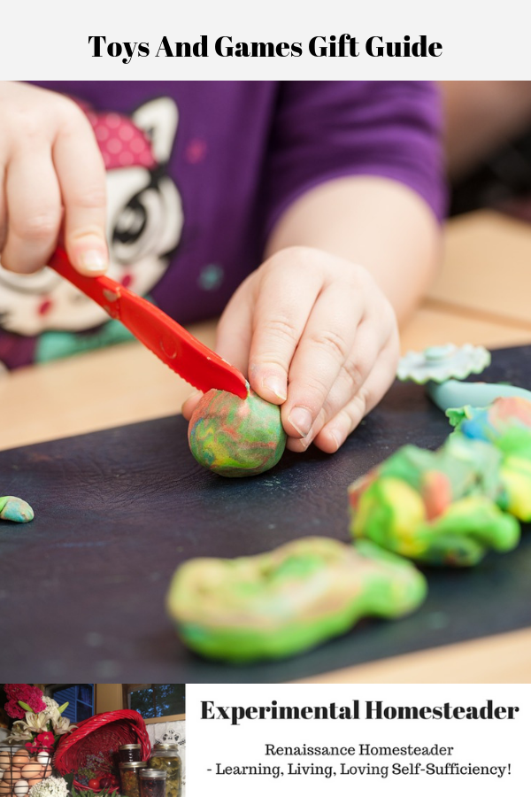 A child playing with Play-Doh.
