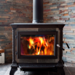 A wood burning stove with a blazing fire.