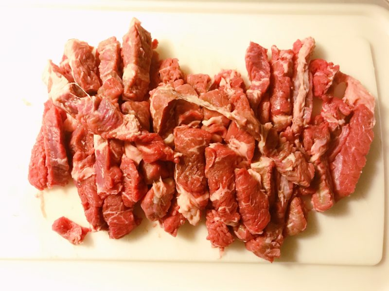 The beef sliced into thin strips.