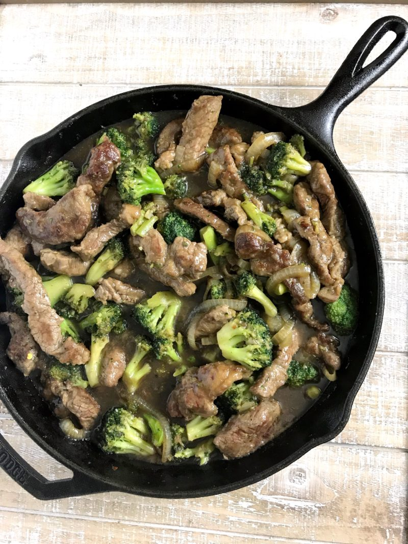 The stir-fry beef and broccoli recipe ready to serve, but still in the cast iron skillet.
