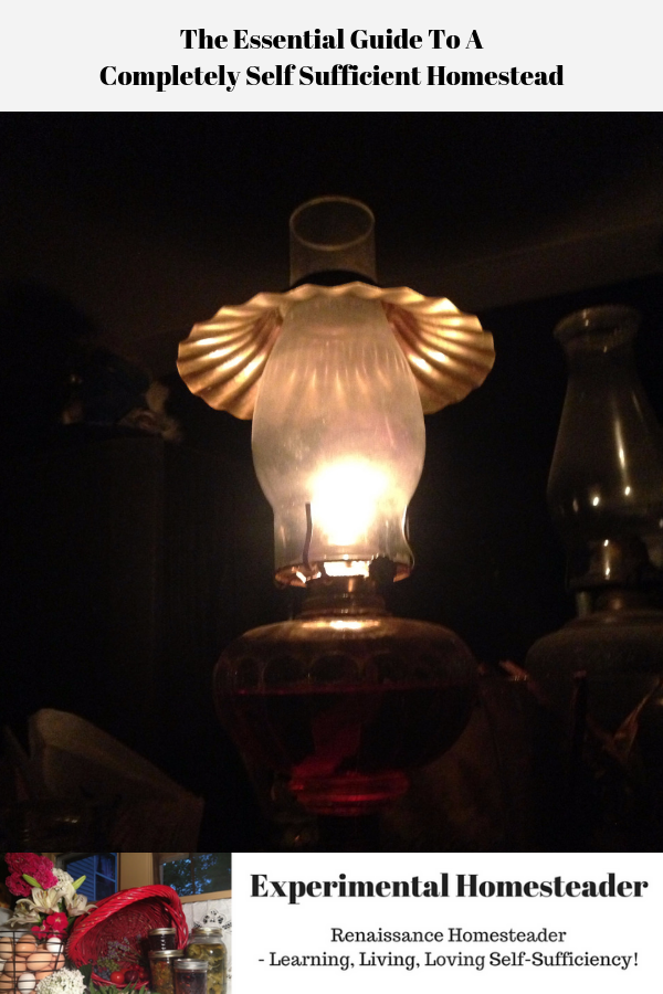 A lighted kerosene lamp sitting on a table.