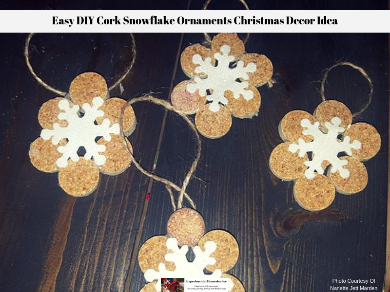 Cork snowflake ornaments laying on a table ready to be hung.