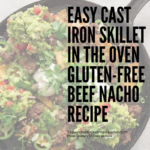 The beef nachos ready to serve in a cast iron skillet.