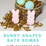 Bunny bath bombs sitting in front of a nest filled with bird egg bath bombs.