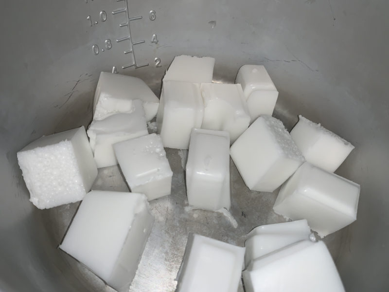 The soap cubes in a soap melting pot.