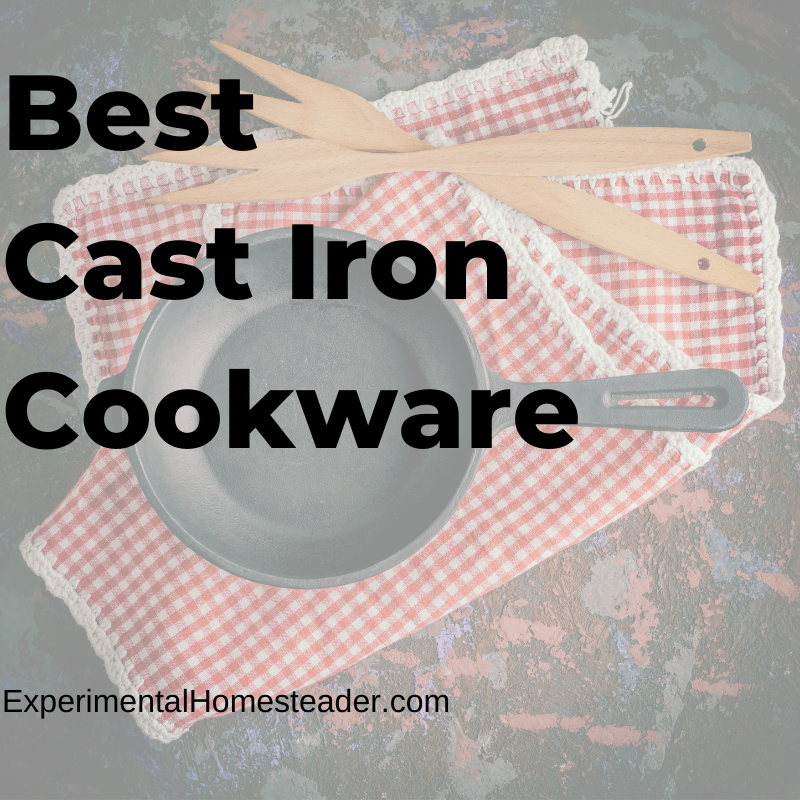 A cast iron skillet sitting on red and white checkered placemats with wooden cooking forks laying beside it.
